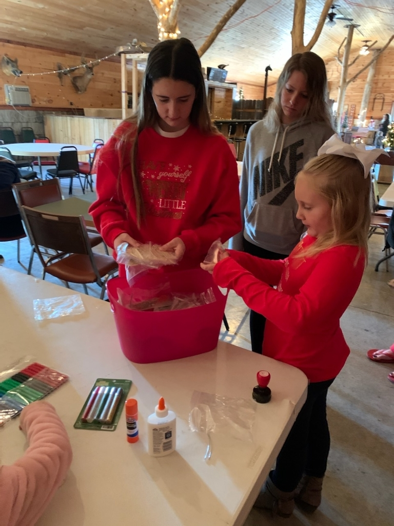 STUCO members helping kids make ornaments for the town Christmas tree